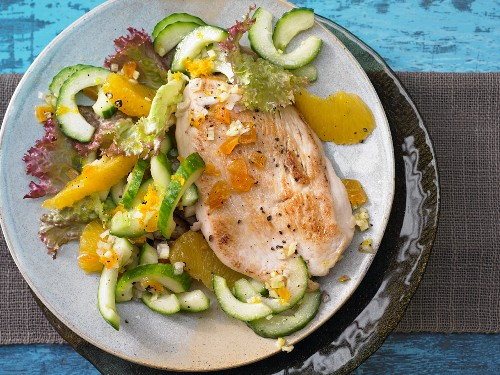 Turkey escalope with orange and cucmber salad