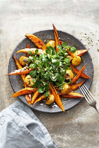 Glazed sweet potato wedges with lamb's lettuce, chestnuts and toasted pumpkin seeds