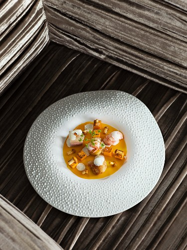 Calf's head and calf's sweetbreads with crayfish, pumpkin and lavender vinegar at the 'Schanz' restaurant in Piesport, Germany