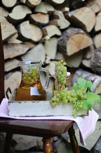 Reproduced in a jar and a flip-top glass bottle on a tray outdoors