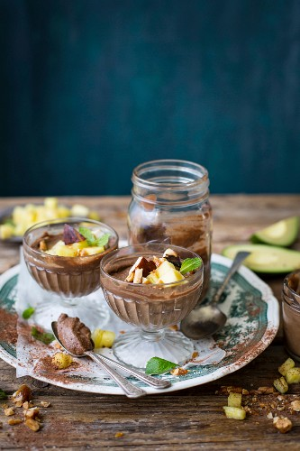 Raw avocado chocolate pudding with coconut, cashews, and pineapple and mint salsa