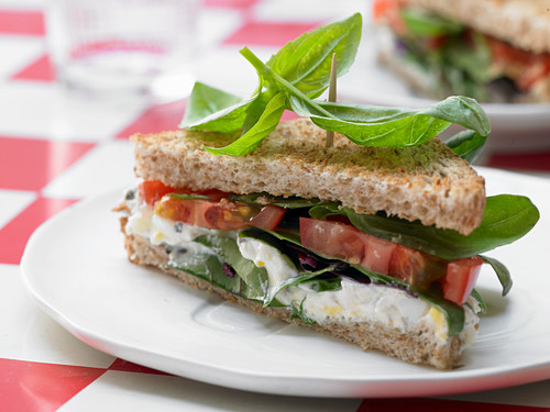 A tomato sandwich with spicy egg cream