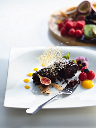 Gluten-free chocolate cake with ganache and marscapone and macadamia cream