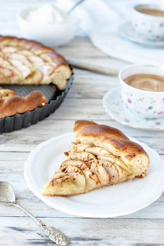 Apple cake made of vegan yeast dough with cinnamon