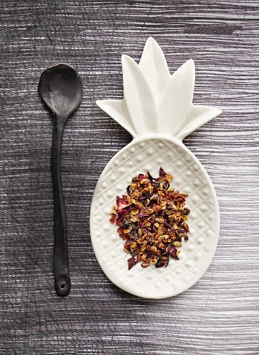 Herbal and fruit tea on a pineapple-shaped serving dish
