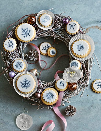 Cookies with stamp decoration arranged on a festive wreath