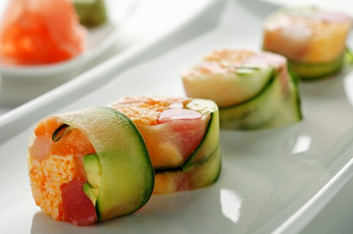 Cucumber rolls filled with tuna, crab and avocado