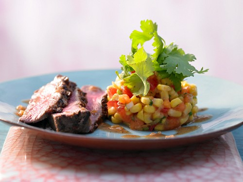 Beef fillets with a corn and papaya salad (Jamaica, Caribbean)