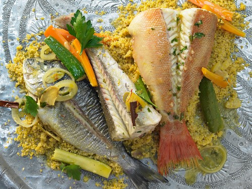 Three varieties of fish with vegetables and saffron couscous