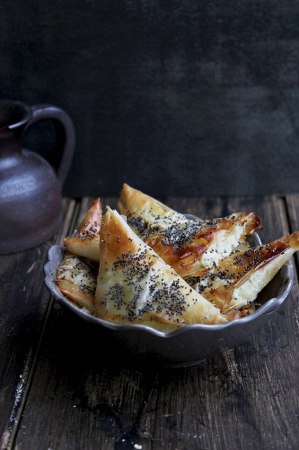 Puff pastries filled with cheese and poppy seed
