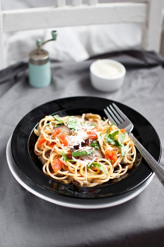 Spaghetti alla Norma with tomatoes, aubergine, grated parmesan and basil