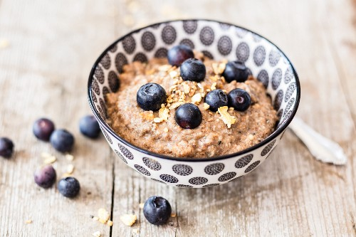 Lupine porridge with dried fruits and blueberries
