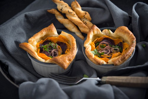 Puff pastry quiche with sweet potatoes, violet potatoes and shallots (vegan)