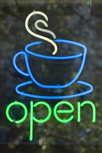 Neon sign in window of American cafe