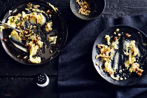 Plates of half-eaten cheese and potato mash (soul food)