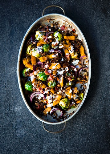 Roasted sweet pumpkins, brussels sprouts flavored with spices and tossed with wild rice topped with bacon bits and a lemon creme fraiche dressing