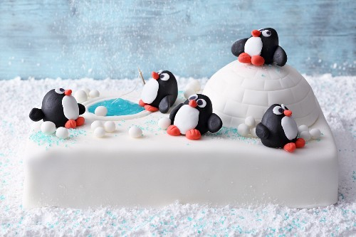 'Winter Wonderland' fondant icing cake with an igloo and penguins