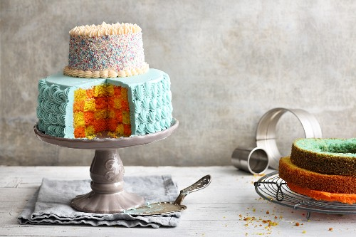 Brightly coloured two-tier checkerboard cake with buttercream