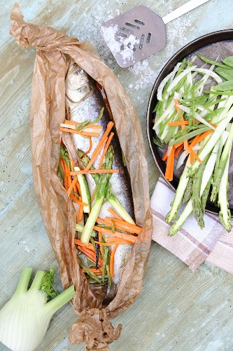 Char wrapped in parchment with spring vegetables and vanilla
