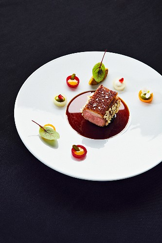 Oriental saddle of lamb, a dish by Jan Hartwig, the chef at the 'Atelier' restaurant in Munich