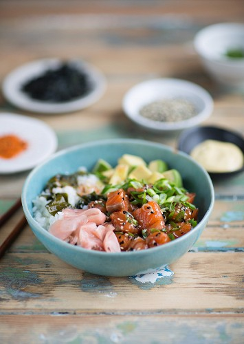 Salmon poke with avocado, spring onions and rice