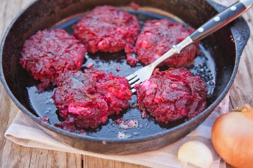 Beetroot meatballs in a pan