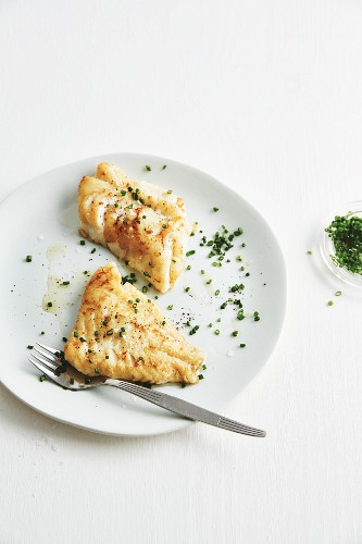 Fried redfish fillet with fresh chives