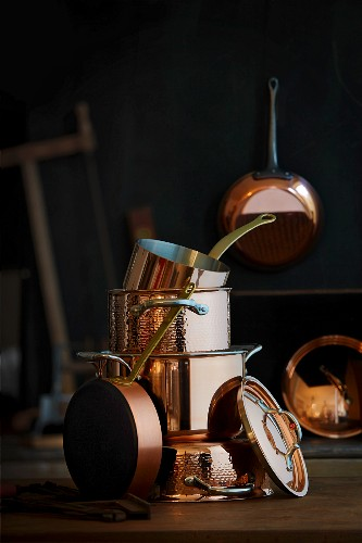 A stack of different copper pots