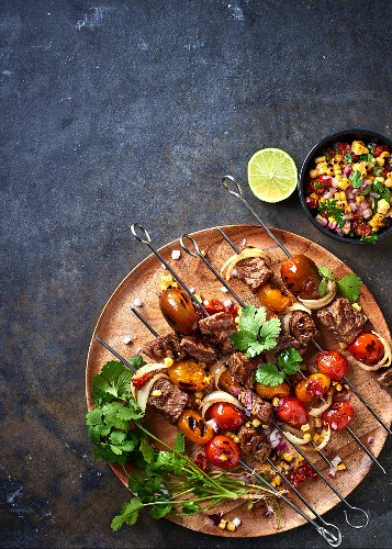 Beef and tomato skewers and a sweetcorn and onion salsa with dried tomatoes