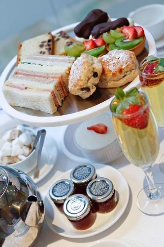 Afternoon tea, champagne, english tea, fruit tartlets, fruit tarts, restaurant, sandwiches, scones