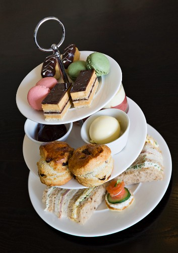 Afternoon tea with sandwiches and cakes