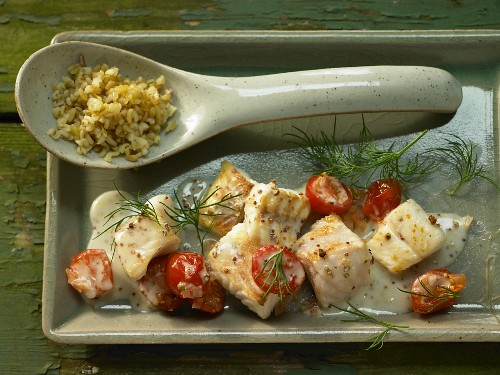 Pan fried zander with coarse mustard, tomatoes and dill