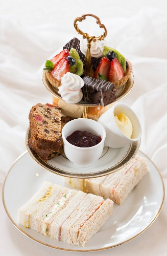 Afternoon tea with cakes, scones and finger sandwiches