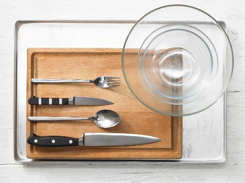 Kitchen utensils for making baked fish with an apple vinaigrette