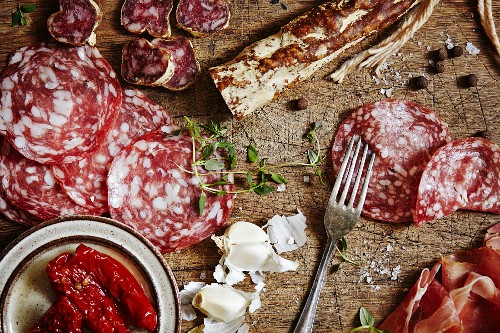 Fine meats and delicatessen. Served on a vintage cutting board.