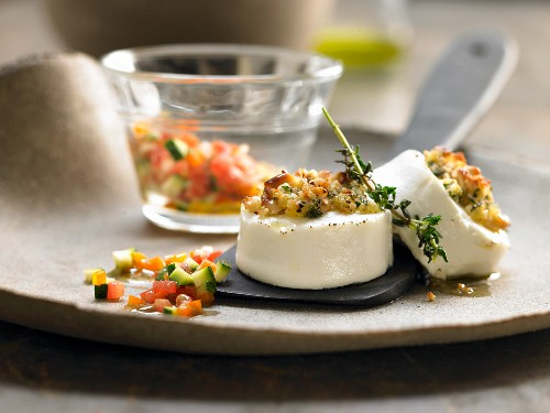Browned goat's cheese with vegetables and herbs
