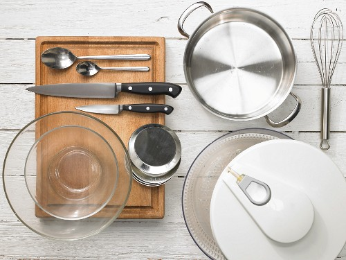 Kitchen utensils for making browned goat's cheese with vegetables and herbs