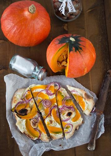 Tarte flambée with pumpkin and onions