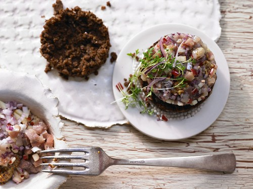 Herring tartare on pumpernickel crumbs with apple, onion and cress
