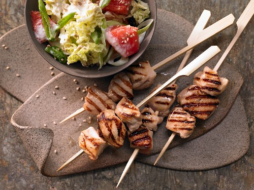Teriyaki chicken skewers with a bok choy and grapefruit salad
