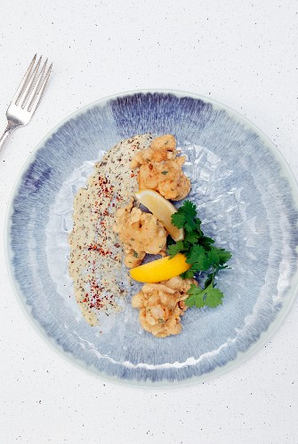 Shrimp fritters with lemon