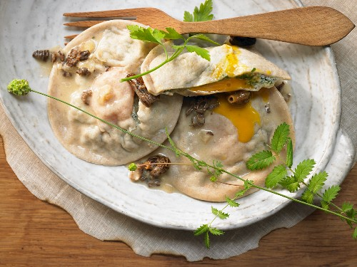 Giant ravioli filled with eggs and herbs with morel sauce