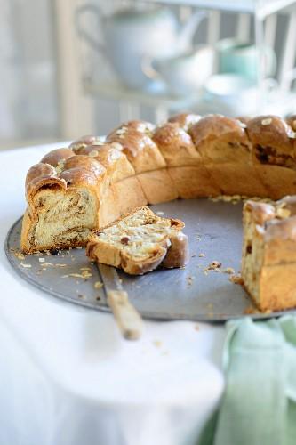 Bread plait with a sugar glaze, sliced