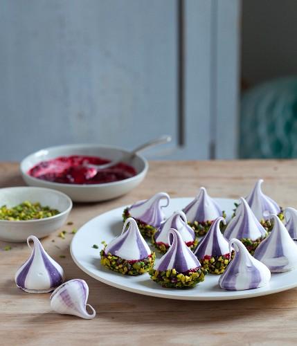 Mini pavlovas with cherry sauce and pistachios