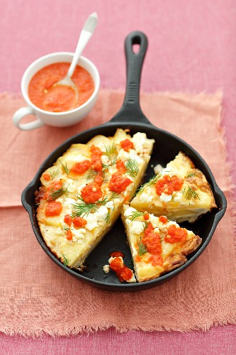 Potato tortilla with feta and roasted pepper sauce