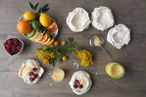 Meringue nests with lemon curd, citrus fruits and raspberries