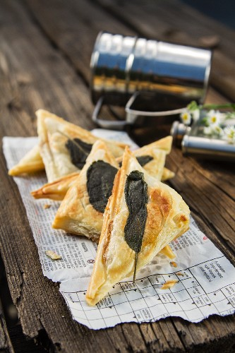 Apple turnovers with sage leaves