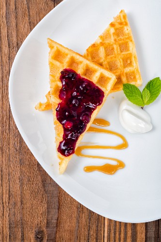 Waffles with berry jam (top view)