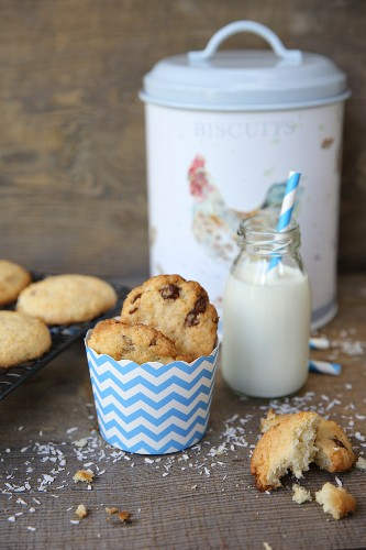 Coconut cookies with chocolate chip and a bottle of milk