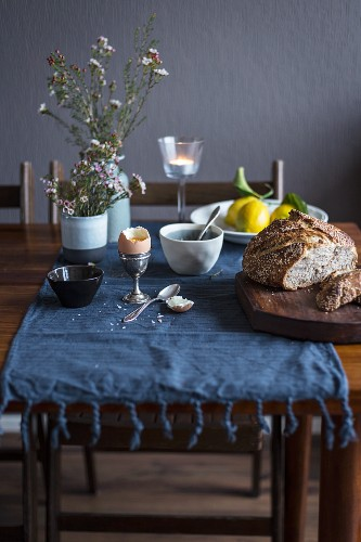 Breakfast table with bread, egg and lemons
